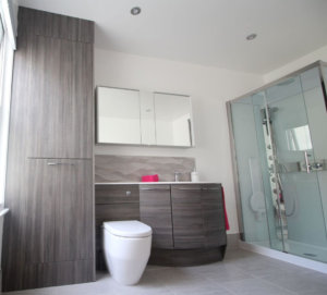 Ensuite bathroom with tall cupboards