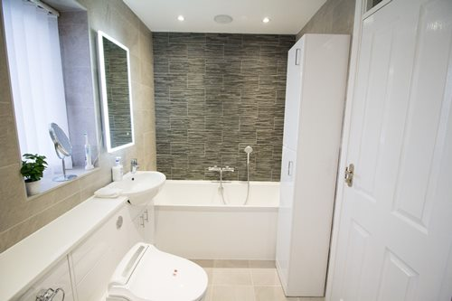 bath with brown tiles