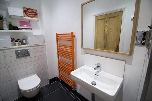 bathroom with orange towel rail